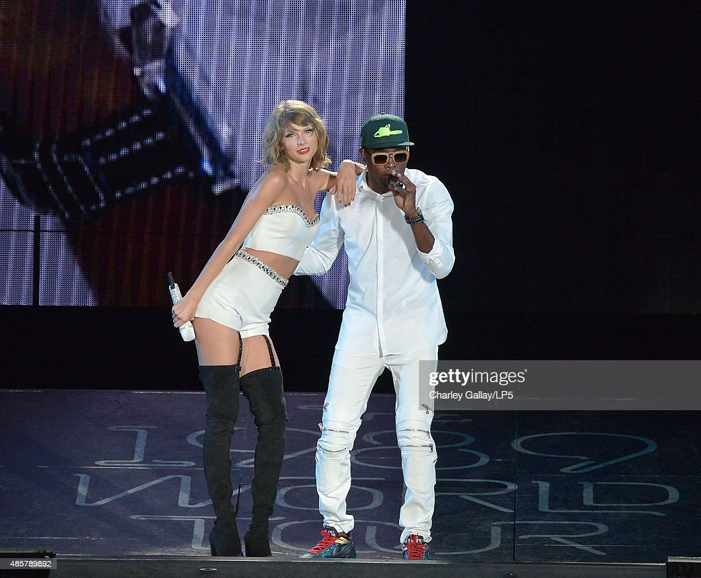 Singer-songwriters Taylor Swift (L) and Omi perform onstage during Taylor Swift The 1989 World Tour Live In San Diego at PETCO Park on August 29, 2015 in San Diego, California.