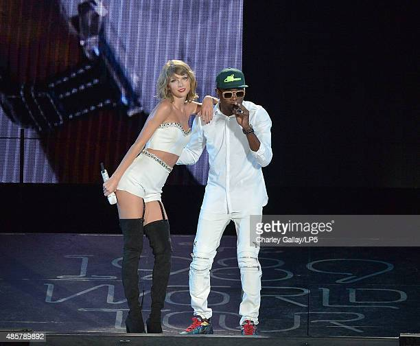 Singersongwriters Taylor Swift and Omi perform onstage during Taylor Swift The 1989 World Tour Live In San Diego at PETCO Park on August 29 2015 in...