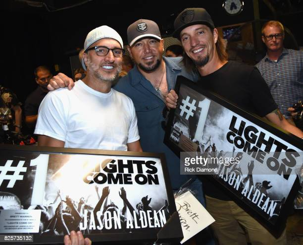 Singer/Songwriters The Warren Brothers Brad Warren and Brett Warren with Singer/Songwriter Jason Aldean backstage at Wildhorse Saloon on August 2...