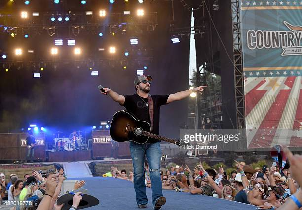 Singer/Songwriters Tyler Farr performs at Country Thunder Day 3 In Twin Lakes Wisconsin on July 25 2015 in Twin Lakes Wisconsin