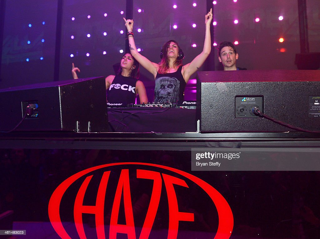 Singer/songwriters Yasmine Yousaf, Jahan Yousaf and producer Kris 'Rain Man' Trindl of Krewella perform onstage at a private party celebrating CES 2014 hosted by iHeartRadio featuring a live performance by Krewella at Haze Nightclub at the Aria Resort & Casino at CityCenter on January 8, 2014 in Las Vegas, Nevada.