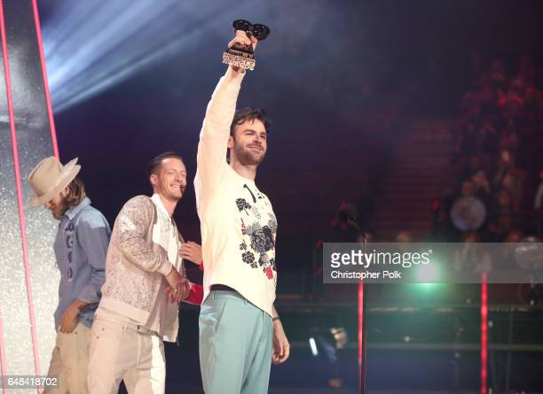 Singerssongwriters Brian Kelley and Tyler Hubbard of music group Florida Georgia Line present the Brand New Artist award to recording artist Alex...