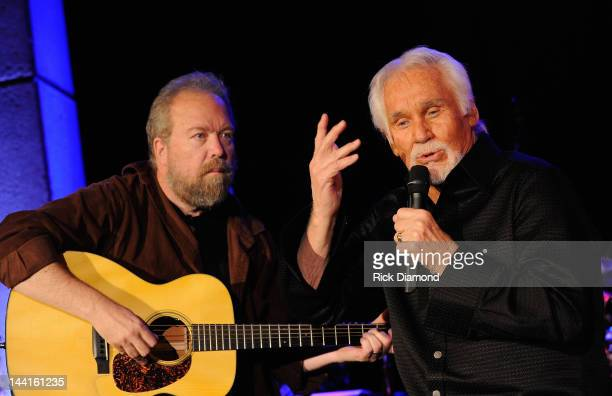 Singers/Songwriters Don Schlitz and Kenny Rogers perform at the Country Music Hall Of Fame And Museum's in the Ford Theater as part of Kenny's...