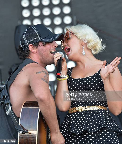 Singers/Songwriters Joshua Scott Jones and Meghan Linsey of Steel Magnolia perform at the First Annual Delta Country Jam Day 1 on October 4 2013 in...