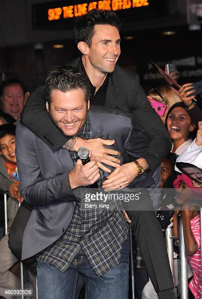 Singers/tv personalities Blake Shelton and Adam Levine of Maroon 5 attend the Universal CityWalk Tree Lighting Ceremony at Universal CityWalk on...