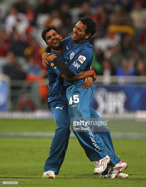 Singh congratulates Rohit Sharma of the Deccan Chargers after running out Ajit Agarkar of Kolkata during the IPL T20 match between Deccan Chargers...