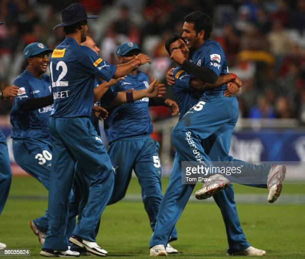 Singh lifts Rohit Sharma of the Deccan Chargers after running out Ajit Agarkar of Kolkata during the IPL T20 match between Deccan Chargers and...