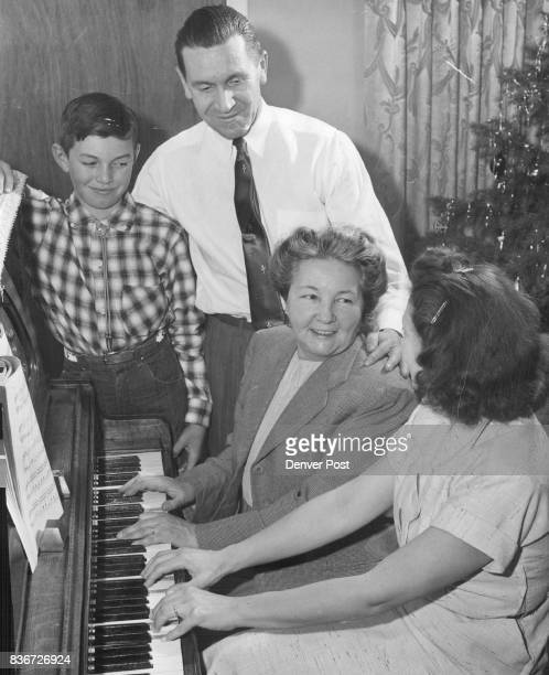 Singing a song of freedom Wednesday night are Csaba Kent Julius Kent Mrs Irene Berecz and her daughter Mrs Eva Kent at the Kent home 1725 S Bryant St...