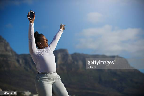singing along to your favourite song in the sun as if no one is watching - worshipper stock pictures, royalty-free photos & images
