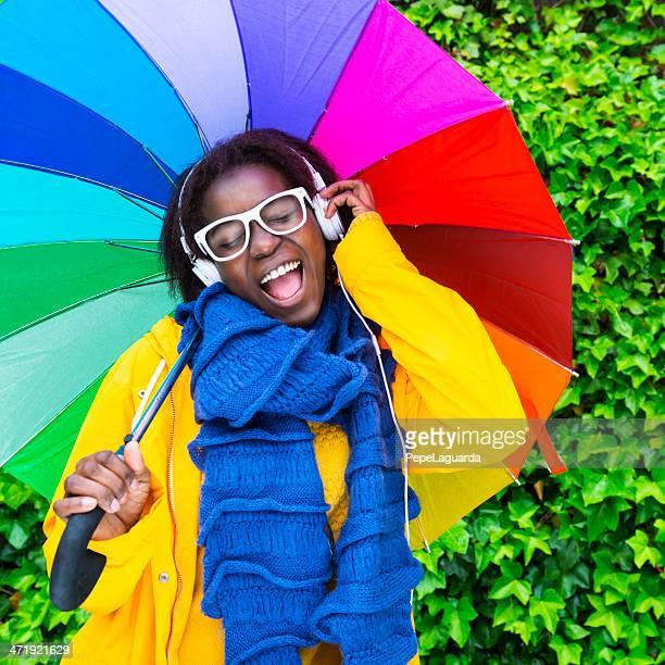 Singing and enjoying music under the rain