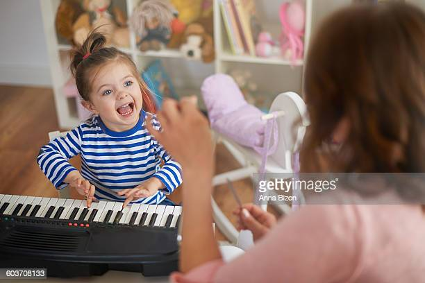 singing and playing on musical instruments with my mommy. debica, poland - anna song imagens e fotografias de stock