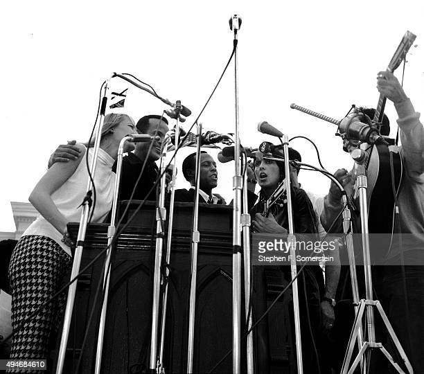 Singing before 25,000 civil rights marchers following speech by Dr. Martin Luther King, Jr. - Mary Travers, left; Harry Belafonte, 2nd on left; Leon...