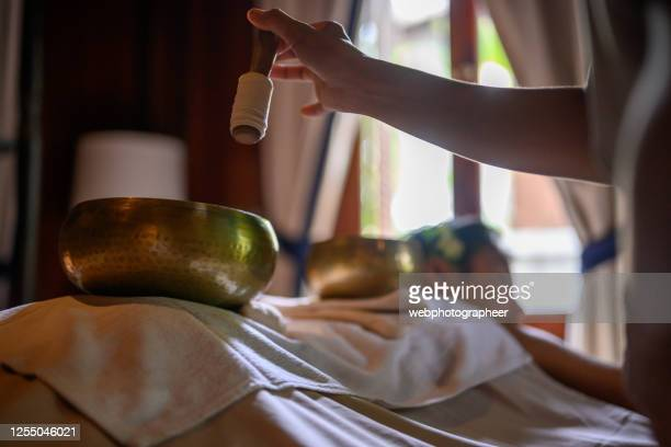 singing bowls treatment - rin gong stock pictures, royalty-free photos & images