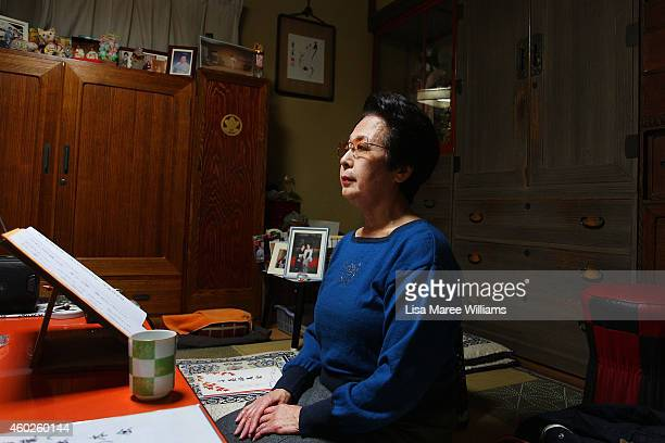 A singing client of Geisha Yuko Asakusa prepares to sing at her home studio in the Asakusa District on November 6 2014 in Tokyo Japan 91 year old...