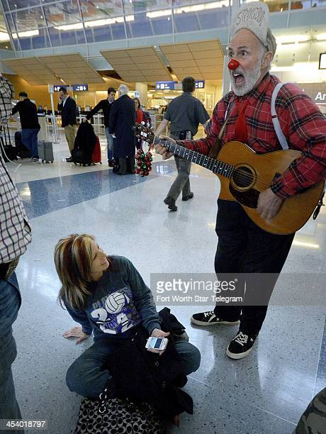 Singing clown Stringbini tries to cheerup Shannon Barnes of Fort Worth who has been waiting 8 hours for a flight to Las Vages in Terminal D at...
