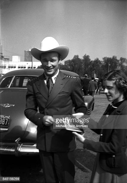 Singing cowboy Roy Rogers is greeted by a fan in Los Angeles California
