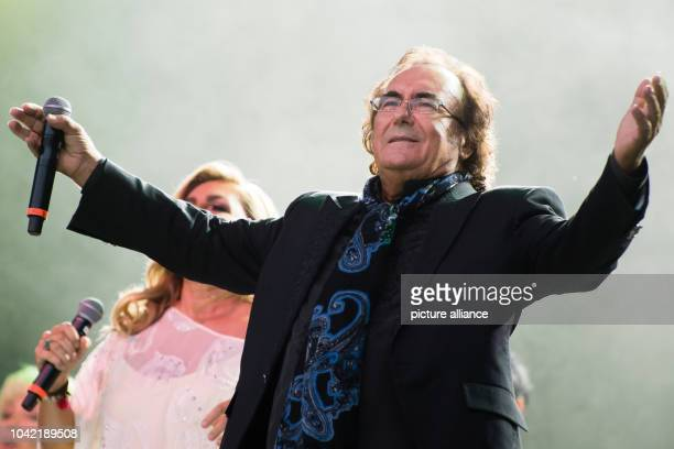 Singing duo Romina Power and Albano Carrisi perform on stage during a concert in Berlin Germany 21 August 2015 The concert was their first in the...