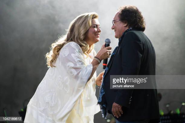 Singing duo Romina Power and Albano Carrisi perform on stage during a concert in Berlin Germany 21 August 2015 The concert is their first in the...