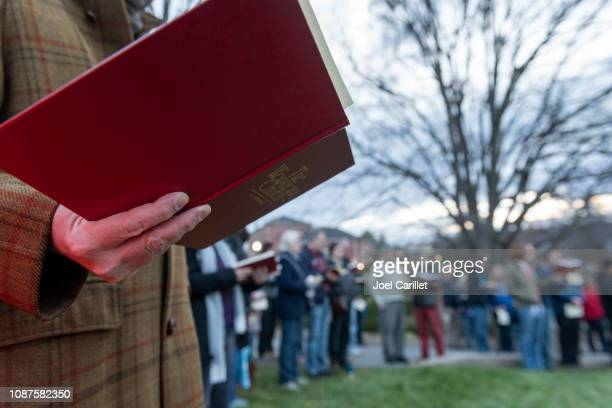 singing from church hymnal at easter sunrise service - easter sunday stock pictures, royalty-free photos & images