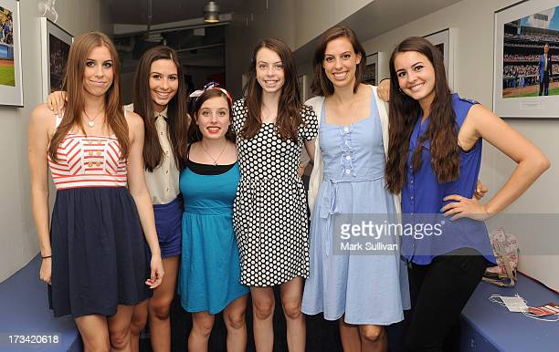 Singing group Cimorelli pose after singing the national anthem before the game between the Los Angeles Dodgers and the Colorado Rockies at Dodger...