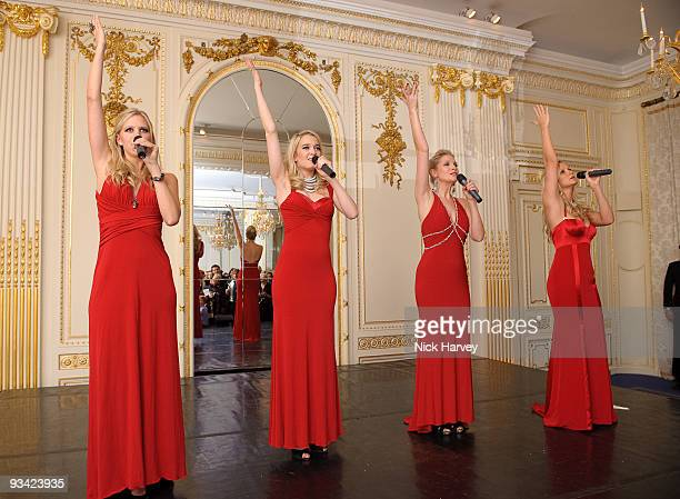 Singing group Passionata consisting of Cecelia de Lisle Amelia Knight Ellie Laugharne and Sophie Elliott attends photocall to switch on Swarovski's...
