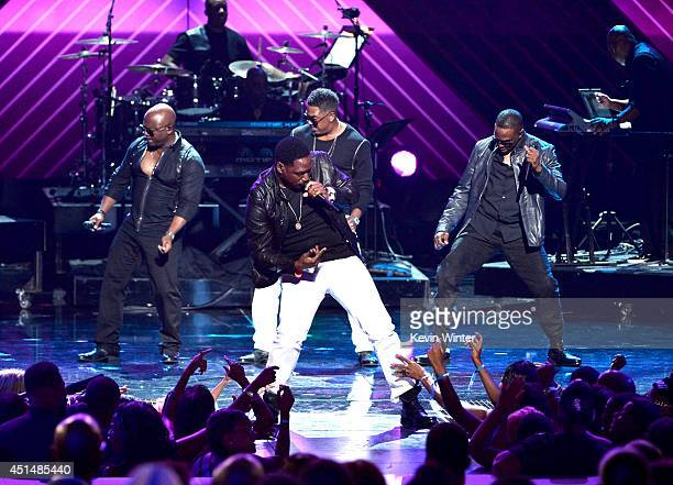 Singing group Silk perform onstage during the BET AWARDS '14 at Nokia Theatre L.A. LIVE on June 29, 2014 in Los Angeles, California.