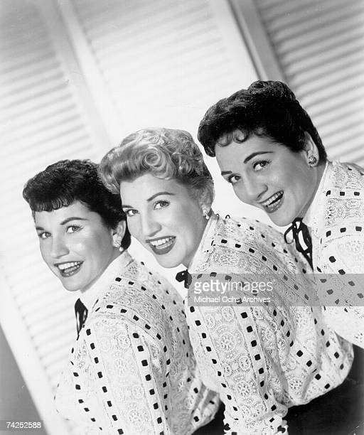 Singing group The Andrews Sisters pose for a portrait circa 1957 in New York City New York