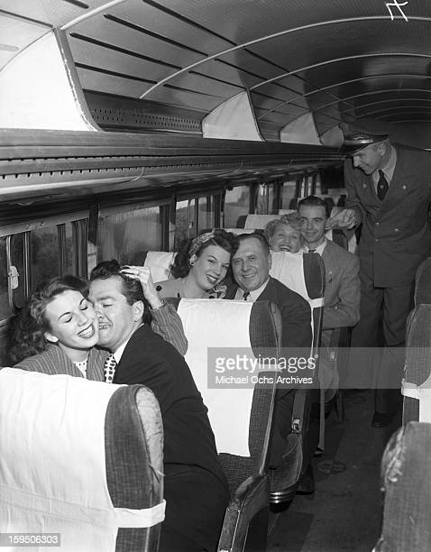 Singing group The Dinning Sisters and husbands ride the Reno bound Greyhound Bus on March 23 1946 in Los Angeles California
