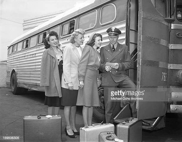 Singing group The Dinning Sisters board the Reno bound Greyhound Bus at the Terminal in Hollywood on March 23 1946 in Los Angeles California