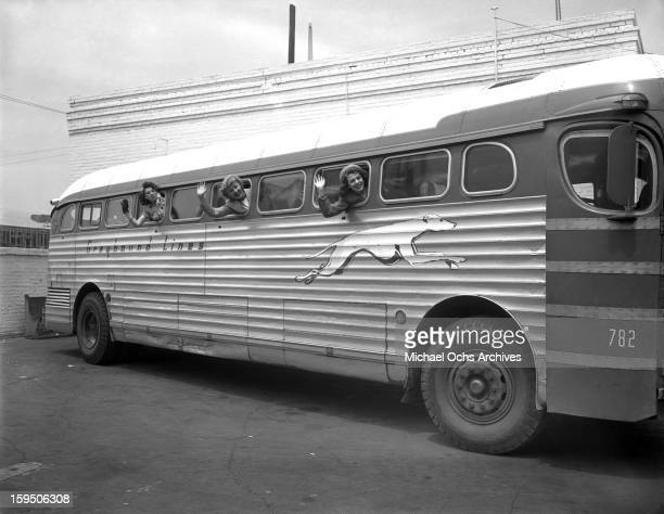 Singing group The Dinning Sisters pose for a photo aboard the Reno bound Greyhound Bus at the Terminal in Hollywood on March 23 1946 in Los Angeles...