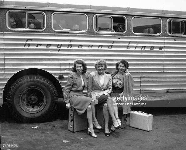 Singing group The Dinning Sisters pose for a portrait as they board a Greyhound bus bound for Reno on March 23 1946 in Los Angeles California