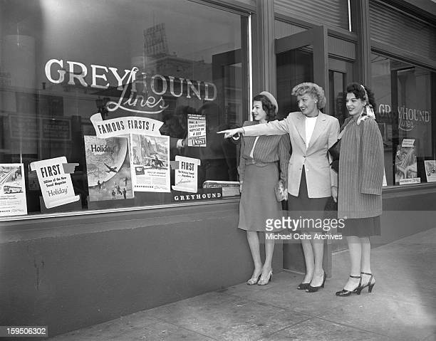Singing group The Dinning Sisters pose for a portrait outside the Greyhound Bus Terminal in Hollywood on March 23 1946 in Los Angeles California
