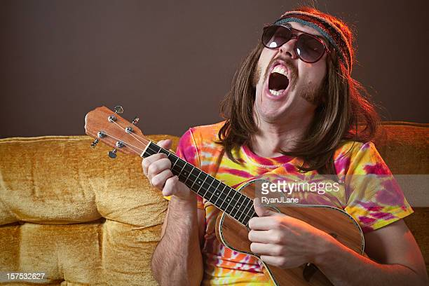 singing hippy man with ukelele - sideburn stock photos and pictures