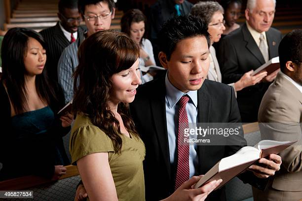 singing hymns in church - congregation stock pictures, royalty-free photos & images