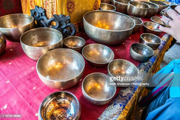 singing indian tibetan bowls - rin gong stock pictures, royalty-free photos & images
