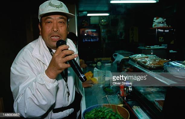 Singing Karaoke in an izakaya (pub), Nishinari Ku, Osaka