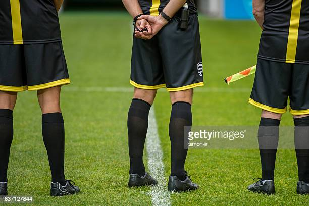 singing national anthem - referee stock photos and pictures