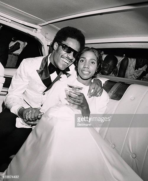 Singing star Stevie Wonder embraces his bride the former Syreeta Wright a Motown songwriter and songstress as they depart Detroit's Bernette Baptist...