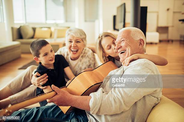 singing together - generational family stock photos and pictures