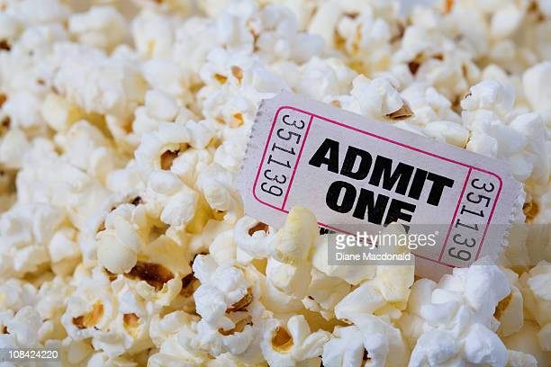 A single Admit One ticket and popcorn