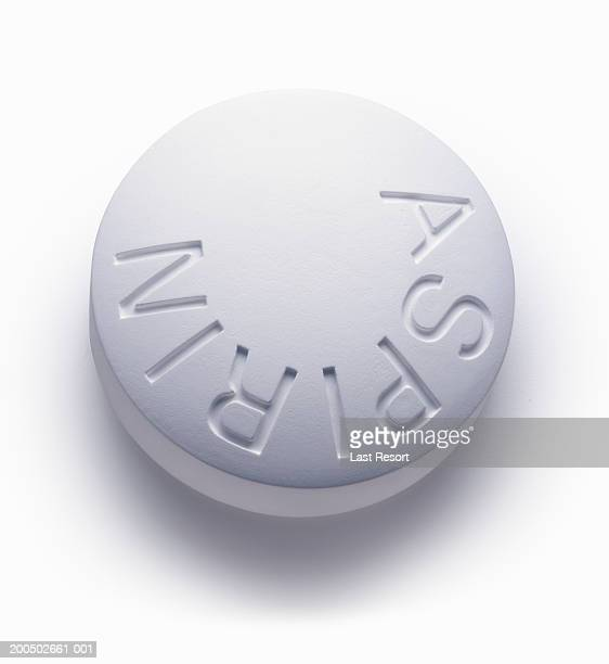 Single aspirin pill, close-up (still life)