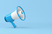 Single blue and white electric megaphone with a handle stands on a blue background