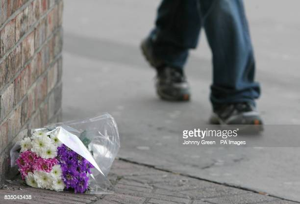 A single bouquet of flowers lie close to a murder scene on London Road in west Croydon south London after a man was fatally stabbed there shortly...