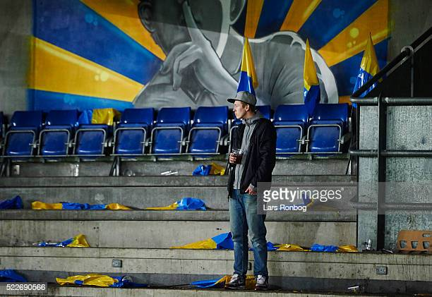 A single Brondby IF fan looks dejected after the Danish Cup DBU Pokalen semifinal match between Brondby IF and FC Copenhagen at Brondby Stadion on...