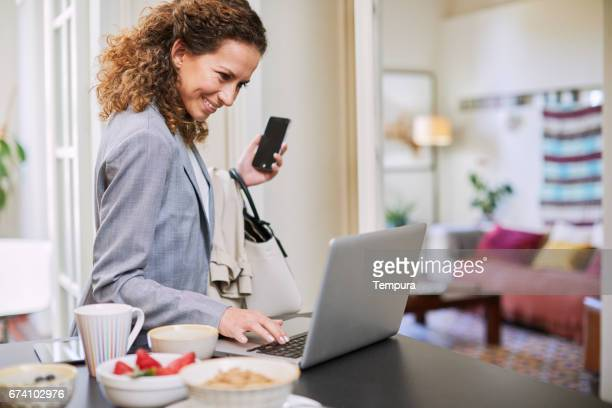 single, businesswoman getting ready in the morning. - beat the clock stock photos and pictures