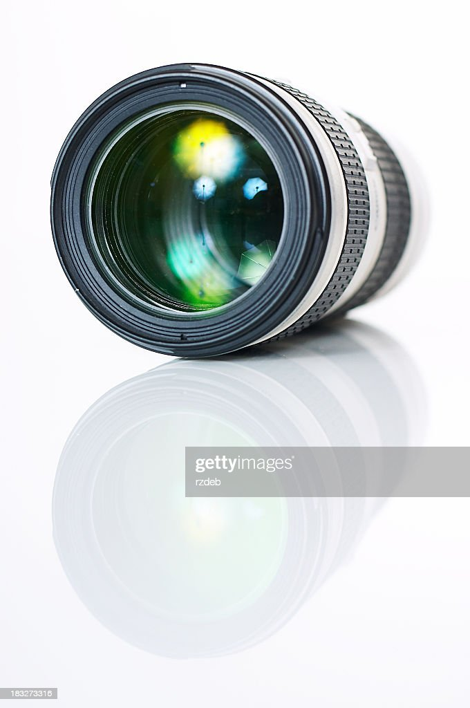 A single camera photo lens reflecting on the surface : Stock Photo