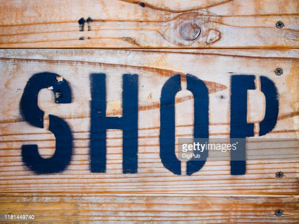 "single capital word ""shop"" on wood - istock images stock pictures, royalty-free photos & images"