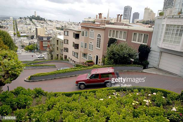 A single car drives down a typically crowded Lombard Street San Francisco's crooked street April 29 2003 in San Francisco With the war in Iraq the...