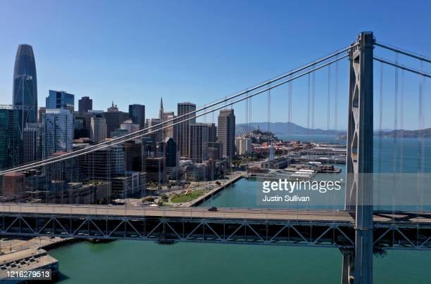 A single car drives west on the San Francisco – Oakland Bay Bridge on April 01 2020 in San Francisco California Officials in seven San Francisco Bay...