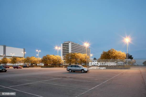 single car in parking at evening - car park stock pictures, royalty-free photos & images